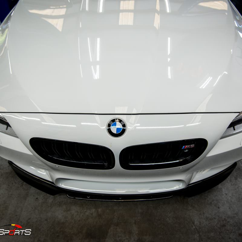 Bmw f10 m5 in for front lip spoiler install. Carbon fibre lip spoiler installed on bmw m5 f10.