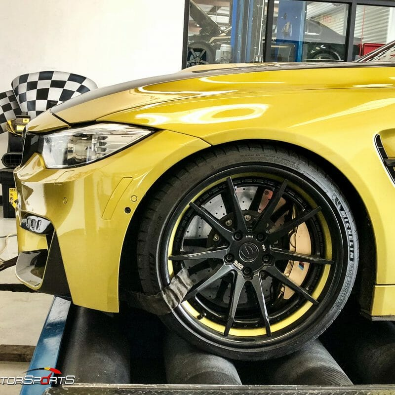 bmw m4 f82 in for power gains downpipes heat exchanger yellow bmw specialists solo motorsports custom tune sms dyno tune downpipes and csf intercooler